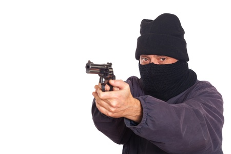 Thief Aiming a Gun on a Robbery Stock Photo - 8624640