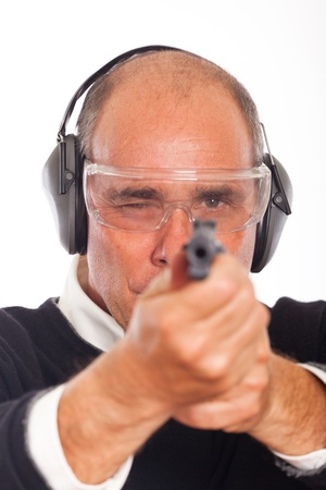 eye protectors: Man Pointing a Gun on White Background