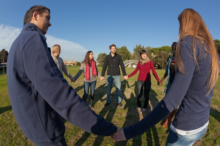 Multiracial Young People Holding Hands in a Circle Stock Photo - 8701360