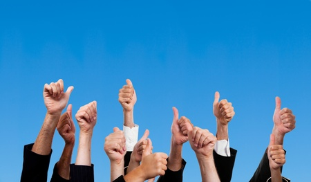 multiethnic: Multiracial Thumbs Up Against Blue Sky