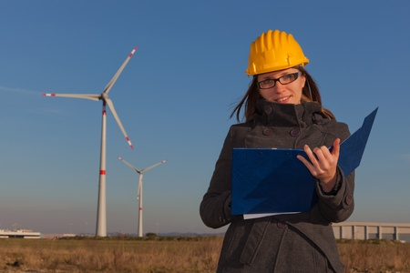 Female Technician Engineers in Wind Turbine Power Generator Station photo