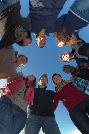 friendship circle: Multiracial People Holding Hands in a Circle, Low Angle View