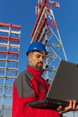 Engineer with Computer in Construction Site photo