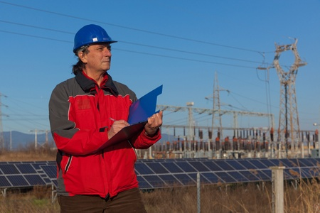 Engineer at Work In a Solar Power Station photo