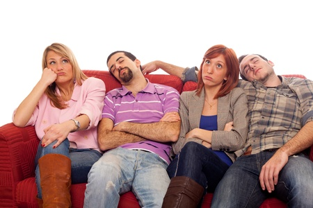 bored woman: Bored Girls while Man Sleeping on Sofa Stock Photo