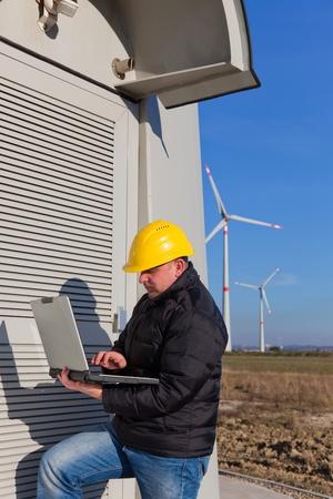 Technician Engineer in Wind Turbine Power Generator Station  photo