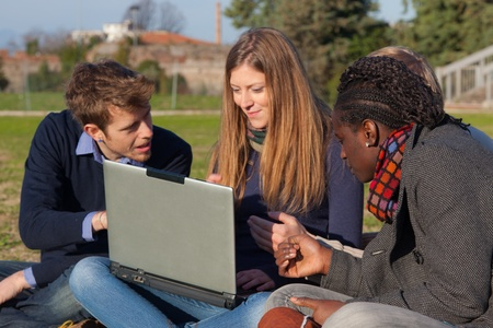 College Students with Computer at Park photo