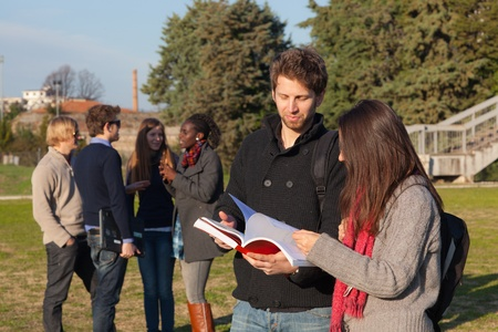 College Students Walking and Talking at Park Stock Photo - 9156786