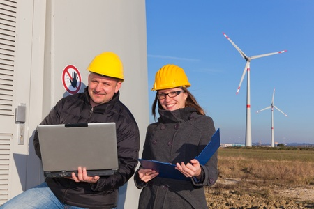 Two Engineers in Wind Turbine Power Generator Station photo