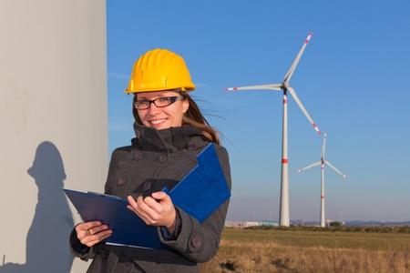energy generation: Female Engineer in Wind Turbine Power Generator Station Stock Photo