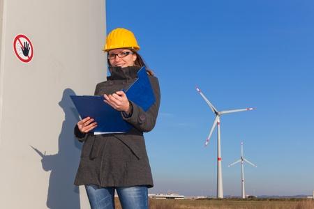 Female Engineer in Wind Turbine Power Generator Station photo