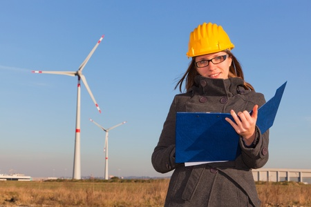 Female Engineer in Wind Turbine Power Generator Station photo