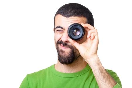 Young Man Looking Through Lens photo