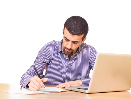 computer writing: Young Man at Work in Office