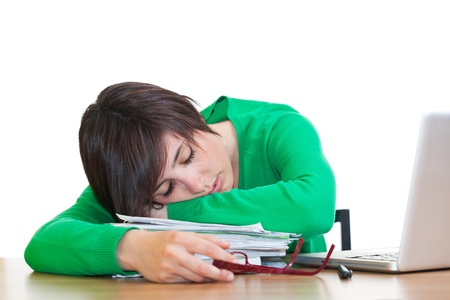 Tired Young Woman Sleeping at Work photo