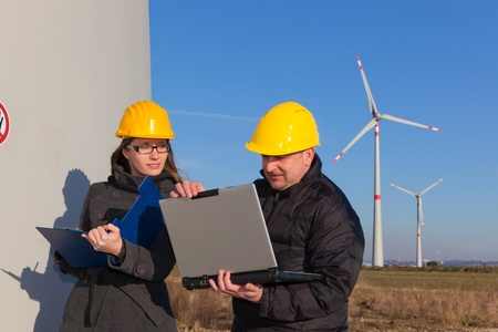 Two Engineers in Wind Turbine Power Generator Station Stock Photo - 9539027