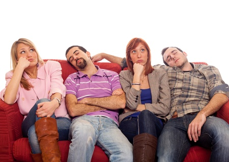 Bored Girls while Man Sleeping on Sofa Stock Photo