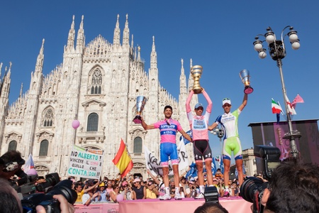 MILANO, ITALY - MAY 29: Alberto Contador with Pink Jersey, winner of the Giro dItalia of 2011 with 2nd arrived Michele Scarponi and 3rd Vincenzo Nibali on May 29, 2011 in Milano, Italy