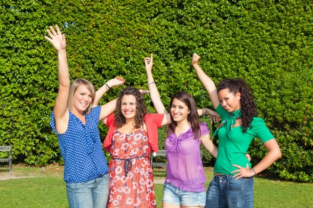 Happy Teenage Girls with Outstretched Arms photo