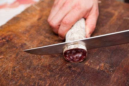 Butcher Slicing Salami Stock Photo - 9847191