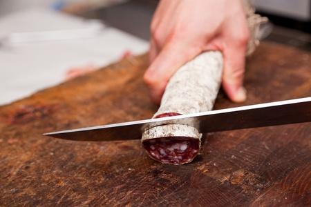 Butcher Slicing Salami Stock Photo - 9847190