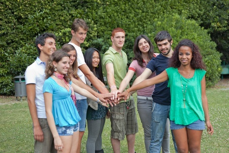 Happy Teenage Group with Hands on Stack Stock Photo - 9984915