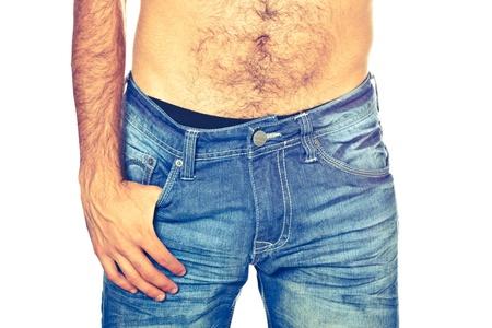 ni�o sin camisa: Hombre joven con pantalones vaqueros, Close Up Foto de archivo