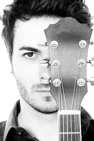 guitarists: Young Man with Guitar Portrait