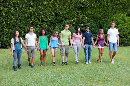 integrated groups: Group of Teenagers at Park Stock Photo