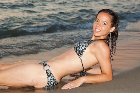 beachwear: Sexy Girl with Bikini on the Beach at Sunset