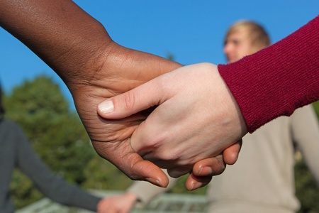 congregation: Multiracial Young People Holding Hands in a Circle Stock Photo