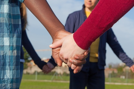 people holding hands: Multiracial Young People Holding Hands in a Circle Stock Photo