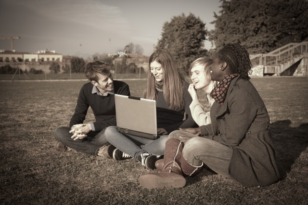 College Students with Computer at Park Stock Photo - 10459143