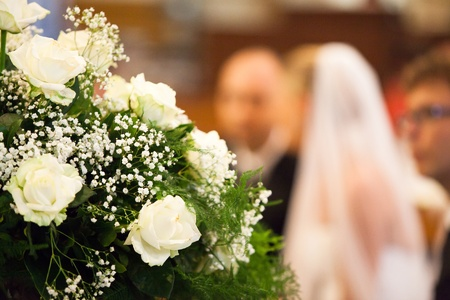 church flower: Selective Focus View of Bride and Groom Stock Photo