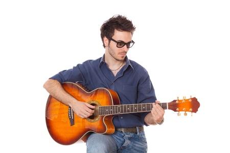 guitar player: Young Man Playing Guitar Stock Photo