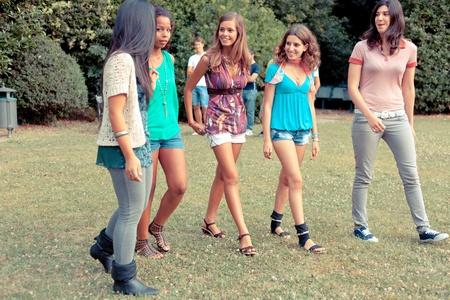 Teenage Girls Walking at Park photo