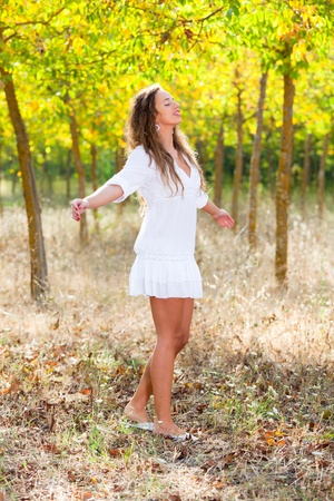 Young Woman Outside with Open Arms, Freedom Sensation photo