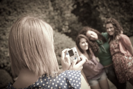 photo shooting: Girl Taking Photos to Her Friends Stock Photo