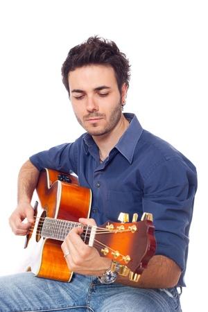 Young Man Playing Guitar photo
