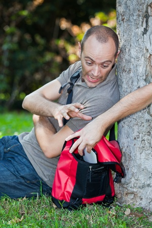 pickpocket: Pickpocket in Action at Park Stock Photo