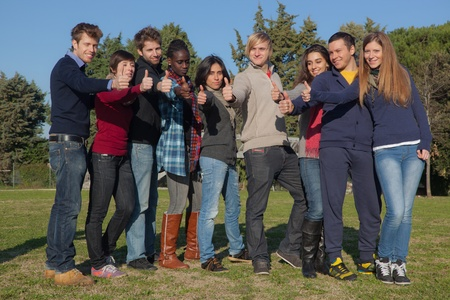 thumbs up group: Happy College Students with Thumbs Up