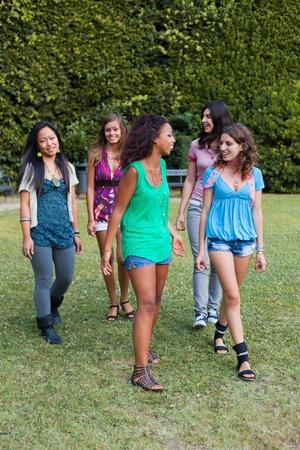integrated groups: Teenage Girls Walking at Park