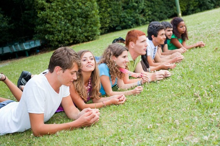 Group of Teenagers Lying on the Ground at Park photo