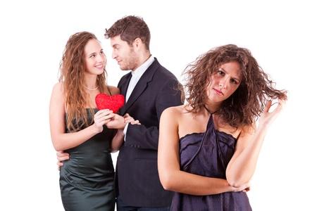 jealous: Sad Woman with Happy Couple on Background