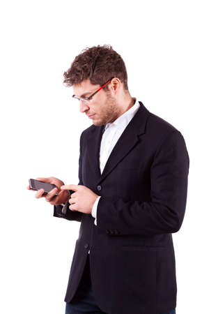 dialing: Young Businessman with Smartphone on White