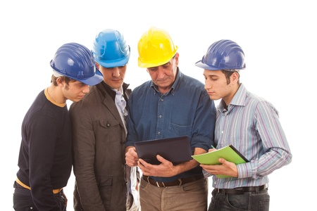Engineers or Architects with Helmet on White Background photo