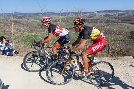 gilbert: SIENA, ITALY - MARCH 03: Fabian Cancellara and Philippe Gilbert during the 2012 Edition of Strade Bianche, bicycle race across tuscan hills, in March 03, 2012 in Siena, Italy