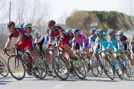SIENA, ITALY - MARCH 03: Group of Cyclists during the 2012 Edition of Strade Bianche, bicycle race across tuscan hills, in March 03, 2012 in Siena, Italy