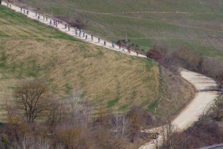 SIENA, ITALY - MARCH 03: Group of Cyclists during the 2012 Edition of Strade Bianche, bicycle race across tuscan hills, in March 03, 2012 in Siena, Italy Stock Photo - 12513374