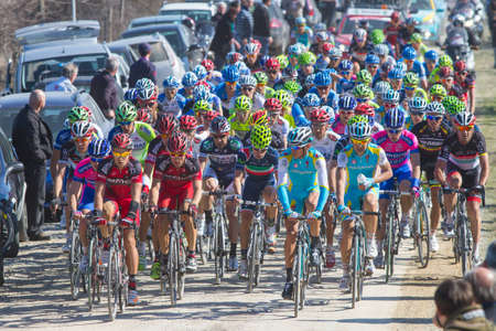 SIENA, ITALY - MARCH 03: Group of Cyclists during the 2012 Edition of Strade Bianche, bicycle race across tuscan hills, in March 03, 2012 in Siena, Italy Stock Photo - 12513395